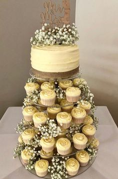 Eschew the traditional wedding cake in flavour of a quirky cupcake tower wedding cakes with cupcakes 20 wedding cupcake tower ideas for your big day