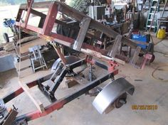 Homemade dump trailer constructed from tubing, an axle, and electric winch. Trailer Axles, Atv Trailers, Dump Trailers, Car Trailer, Utility Trailer, Trailer Plans, Trailer Build, Metal Projects, Welding Projects