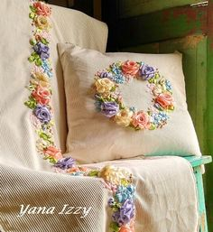 Cushion and tablecloth with ribbon embroidery