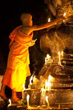 Young Monk lighting candles in Luang Prabang, Laos. (His robe looks dangerously close to the flames! Gautama Buddha, Buddha Buddhism, Buddhist Monk, Laos, Robert Doisneau, Zen, Pema Chodron, Vientiane, Luang Prabang