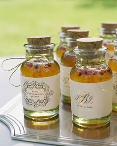 Jars of peppercorn honey with customized labels as wedding favors