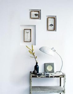 Recessed frames on a white wall