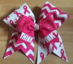"""Cheer bow""""think pink"""" October cancer awareness."""