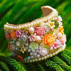 The charm bracelets pictures give you ideas about making charm bracelets. With Pandahall beads you can finish the charm bracelets perfectly! Embroidery Bracelets, Bead Embroidery Jewelry, Fabric Jewelry, Beaded Embroidery, Jewelry Crafts, Jewelry Art, Beaded Jewelry, Flower Jewelry, Jewelry Ideas