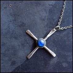 Nino  Sterling silver cross pendant with solid opal by Plysperk, $61.00