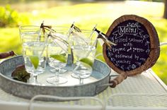 Love the organic use of a tree stump for a menu for this dinner party