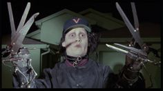Image of movie screencaps for fans of Edward Scissorhands. the man created with sissors for hands by an inventor comes to live in the 'real' world.