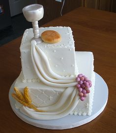 The swags leading wheat and grapes to wine and bread is interesting.    First Communion Cake by JacqueOH, via Flickr
