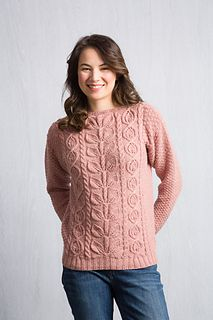 Botanical themed cables are bordered in double moss stitch in this luscious modified drop shoulder pullover.