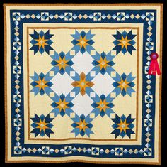 2015 Quilt Expo Quilt Contest, 2nd Place, Category 1, Hand-quilted Bed Size-Pieced: Star Flower, Karen Capps, Madison, Wisc. quiltexpo.com