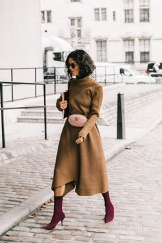 High necks are a classic vintage feature and this brown knitted dress and modern boots are a great combination. | At Last, The Secret To Cool Girl Vintage Style Is Revealed!