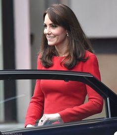 The Duchess of Cambridge appeared to brush her famous fringe to the side for this outing but sported her trademark smoky eye make-up