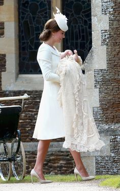 The Duchess of Cambridge holding Princess Charlotte at her christening in Sandringham