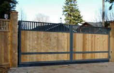 Wood and Iron Sliding Gate Wrought Iron Wood Fence Modern Fence Company Fort Smith Fence Eastern Oklahoma Fencing Metal Driveway Gates, Wooden Garden Gate, Wooden Gates, Fence Gates, Wood Fences, Front Gates, Outdoor Paving, Wood Fence Design, House Gate Design