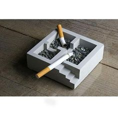 This cement (concrete) ashtray is divided into 3 rooms, giving heavy smokers more choices of space to smoke (even by the stairs!). For non-smokers, these rooms can be turned into organizers for your stationary, such as paper clips or pins.  Modern concrete ashtray crafted by Japanese designer Nobuhiro Sato.