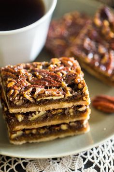 Paleo Pecan Pie Bars   These pecan pie bars are like a mini handheld piece of pie--sounds like a win for us!