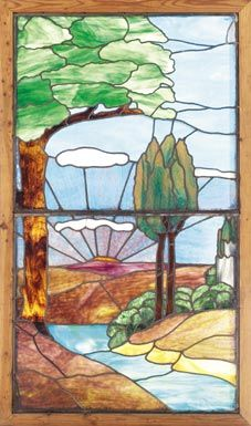 "453.	Arts & Crafts window, leaded glass with strong Arts & Crafts landscape image in shades of blue, green, purple, 34""w x 61""h, excellent condition 1000-1500"