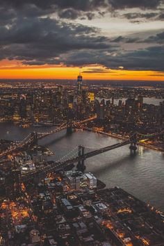 NYC. Low Manhattan at dusk. Brooklyn and Manhattan bridges looking west