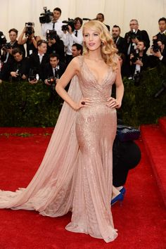 """Blake was the epitome of red carpet glamour at the 2014 Met Ball in her blush embellished Gucci Première gown complete with a train and cape-like feature. Plus, her deep side-swept waves and pink pout (courtesy of NARS lip liner in """"Salsa"""") were a perfect compliment."""