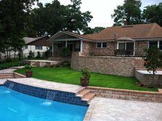 Stonehurst Timberwood paver pool deck with Stonegate Timberwood retaining wall.