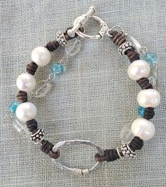 Pearls on Knotted Leather with hand crafted wrapped silver with quartz and blue tourmaline. Silver tone bead accents and clasp. $65.00 on Etsy: https://www.etsy.com/listing/160049005/blue-tourmaline-aquamarine-pearls?ref=shop_home_active