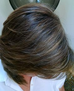"""This is a client of mine in her early sixty's. Instead of the monthly of all over color, """"Babylights"""" of highlights and lowlights blends her grey and leaves her hair more multidimensional, radiant, and natural-looking. A great look for working professional women. ~ www.dmazsalon.com (216) 292-HAIR (4247)"""