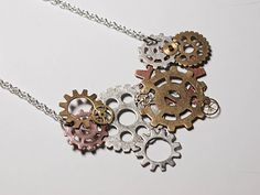 DIY Steampunk Gears Necklace. I need to make this for my sister! She loves any steampunk jewelry!