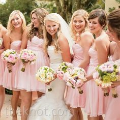 Light pink bridesmaid dresses, cute and love the flowers