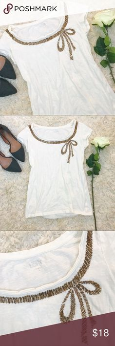 LOFT white scoop neck tee w/ gold beaded bow ✨ Beautiful white T-shirt from Ann Taylor loft. Scoop neckline and gold beading by the neckline. Beading forms a bow design. Short sleeves. Back is plain. Good used condition, although the fabric is thinning a bit. There are no marks or stains. Women's size small. LOFT Tops Tees - Short Sleeve