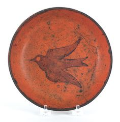 """Pook & Pook. November 11th & 12th 2011. Lot 57. Estimated: $500 - $1000. Realized Price: $889. Pennsylvania redware plate, 19th c., with flying bird decoration, 7 3/8"""" dia."""