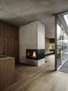 A concrete structure remains exposed inside this residence. It also forms a large chimney breast for the fire at the centre of the upper floor, which divides the kitchen from the lounge.