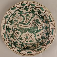 Dish Date: early 15th century Geography: Made in Tuscany, Italy Culture: Italian Medium: Earthenware, tin-glaze (Majolica) Dimensions: Overall: 3 x 14 3/4 in. (7.6 x 37.5 cm)