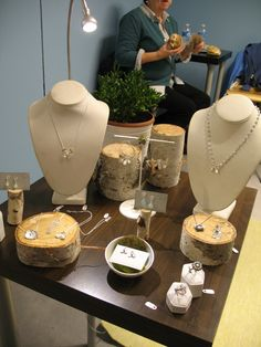 Linen jewelry displays mixed with wood and potted plants - simple  elegant