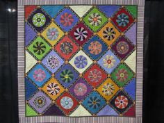"""TarrRequestDedication Timna Tarr was busy this year, getting two quilts into Road.  This one, titled Request and Dedication, started out as a Wheel of Fortune block, but """"after ten years of marriage [to a musician], he finally rubbed off on me and I unintentionally made a record quilt."""""""
