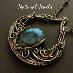Labradorite, I love this stone!! The briolette is upside down, because this way the mysterious shimmer is more visible. I have tried to give a magical touch to the silverwork.