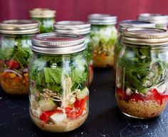 Eat well every day by preparing a week's worth of salads in a jar.  How to make them + plus four fool-proof salad in a jar recipes. ***Greens with too much moisture (dressing) will get soggy. So, dressing goes in first. Self-prepared dressings are healthier. Put 1 1/2 tablespoons of dressing in each pint jar. If you like lots of dressing you could do 2 tablespoons.  Salads are made in 1 pint jars, UK source link here: https://www.pinterest.com/pin/222928250281381933/