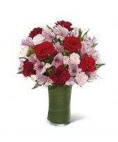 Red roses bouquet with burgundy carnations, pink peruvian lilies, and pink carnations in a clear glass vase lined with a ti leaf. Purple Carnations, Mini Carnations, Pink Flowers, Rose Delivery, Flower Delivery Service, Pink Flower Arrangements, International Flower Delivery, Buy Flowers Online, Red And Pink Roses
