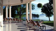 Cooperstown, New YorkThis hotel features a sprawling porch that overlooks Lake Otsego, where guests can relax at any time of day. Supported by columns, the Federal-style porch is as delightful as the town it's located in. (Cooperstown isn Wonderful Places, Beautiful Places, Otsego Lake, Places To Travel, Places To Visit, Porch Garden, Decks And Porches, Beautiful Hotels, Future Travel