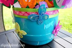 Make party decorations with a plastic pretzel container.