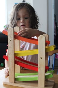Beautiful, natural wooden educational toys can fit into the Montessori infant/toddler environment. Take a Ball Tracking Maze: dropping the balls works on hand eye coordination, focusing and tracking the movement of the balls trains visual skills, the path downwards teaches about gravity, as well as cause and effect!