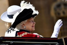 The Monarch cheerily waved to the crowds gathered outside the castle for the historic ceremony