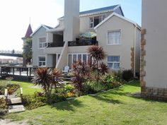 23 Jamaican Palms, Marina Martinique, Jeffreys Bay - Lofts for Rent in Jeffreys Bay, Eastern Cape, South Africa Lofts For Rent, Tree Line, Beautiful Sunset, Palms, Palm Trees, South Africa, Facade, Surfing, Mansions