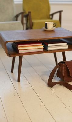 Mid-century teak coffee table with storage ♥ Loved and pinned by https://www.westernstarauctions.com