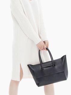 ef8a53689e Hieleven Flap Closure Handbag from Tictail