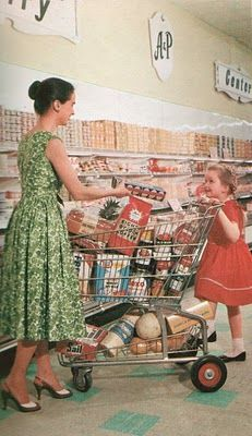 Heels & dress to go to the store. I was dressed like this little girl...dress & little white socks...but I wore tennis or saddle shoes. 1950's.