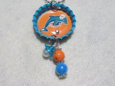Check out this item in my Etsy shop https://www.etsy.com/listing/155497453/miami-dolphins-football-necklacemiami