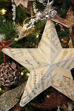 21 DIY Christmas Paper Decorations Music Paper Christmas Star tutorial from Sweet Something Designs The post 21 DIY Christmas Paper Decorations appeared first on Paper Diy. Christmas Spheres, Noel Christmas, All Things Christmas, Diy Christmas Paper Decorations, Paper Ornaments, Holiday Crafts, Paper Garlands, Sheet Music Crafts, Music Paper