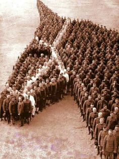 (1918) American soldiers paying tribute to all the horses that lost their life in World War I.