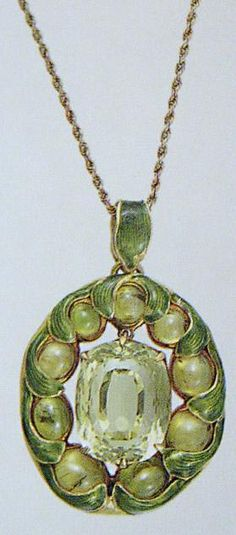 A Tiffany and Co. enamel and green stone necklace, late 19th/early 20th century.