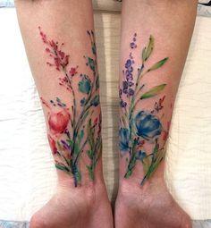 Aleksey Platunov flower tattoo